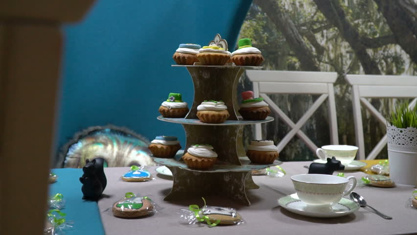 Stand with cakes on the table in the banquet hall