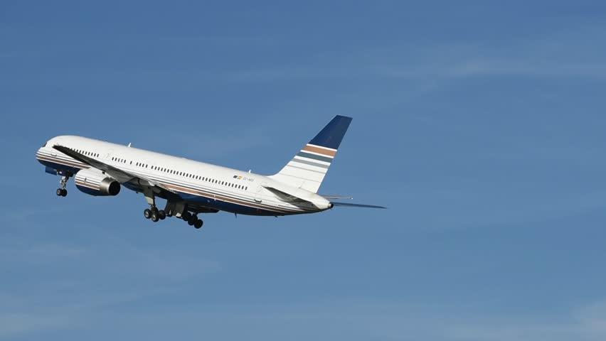 White passenger airplane take off.