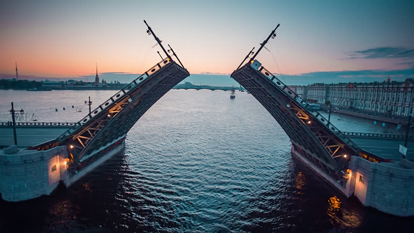 Aerial shot of the Neva river and raised Palace Bridge in St.Petersburg, Russia.