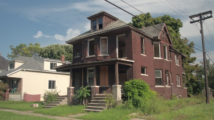 CLOSE UP: Scary brick-built decaying family house after being abandoned and robbed. Haunted mansion in poor ghetto neighborhood. Ruined deserted and demolished residential building in Detroit, USA