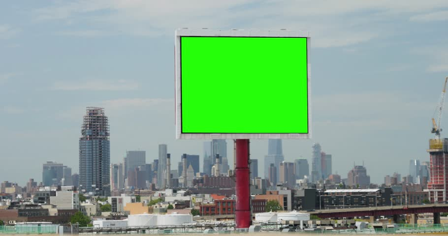 A slowly tracking shot of a green screen billboard in Brooklyn with the Manhattan skyline in the distance.   | Shutterstock HD Video #27851230