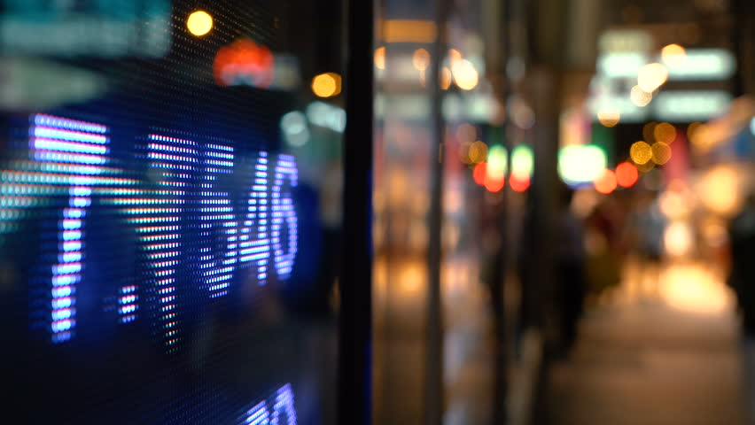 Display of Stock market quotes with city scene reflect on glass | Shutterstock HD Video #27858244