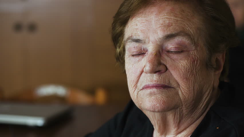 Closeup Portrait Of An Old Woman thoughtful And depressed At Home | Shutterstock HD Video #27860452