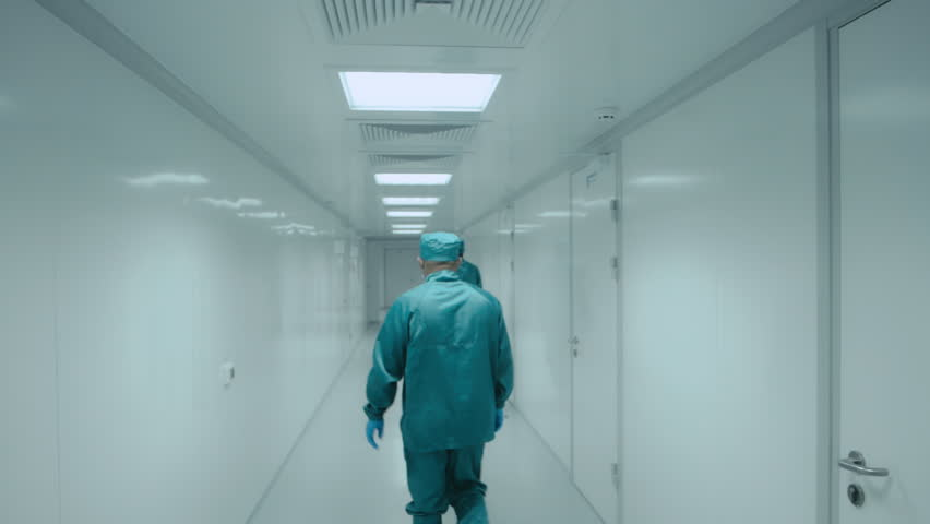 Two pharmacists walk along the white corridor of the laboratory | Shutterstock HD Video #27865918