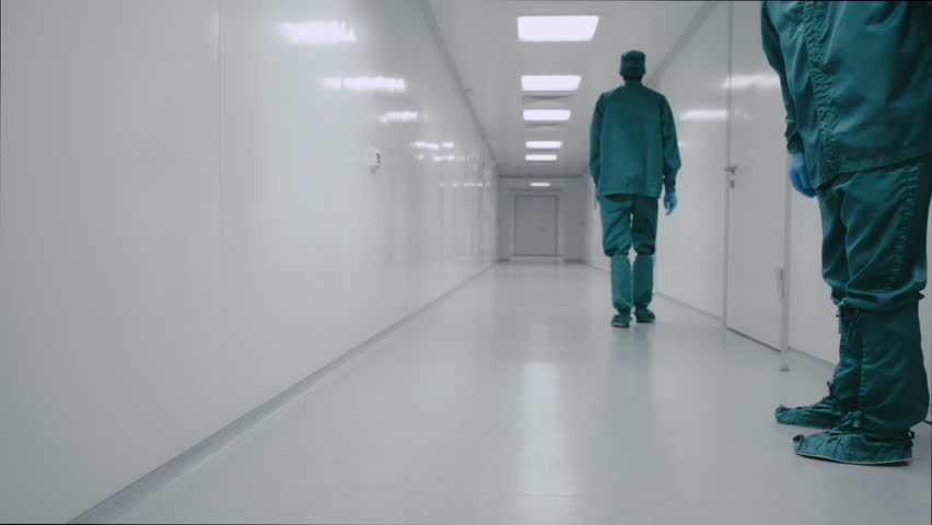 Two pharmacists walk along the white corridor of the laboratory | Shutterstock HD Video #27865927