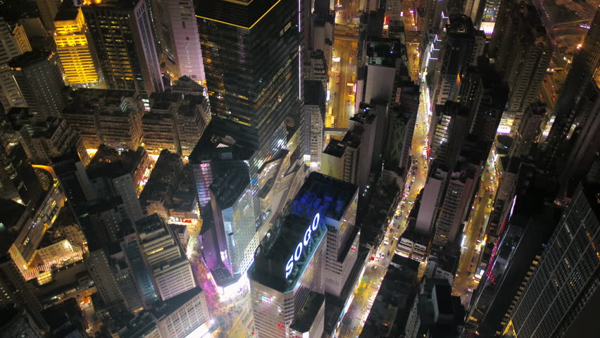 Hong Kong Aerial v26 Flying backwards over Causeway Bay panning up to full cityscape views at night. 2/17   Shutterstock HD Video #27866506