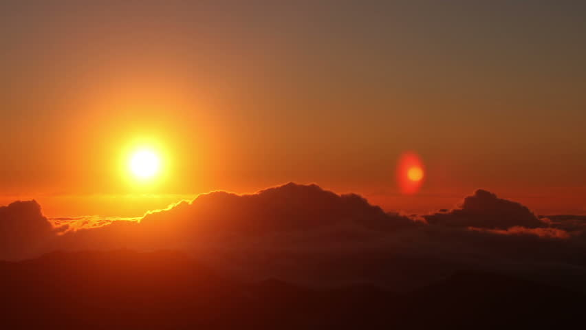 Red sun disk time lapse dawn with flowing cloud waves HDR, shot at Haleakala National Park, Hawaii | Shutterstock HD Video #2786668