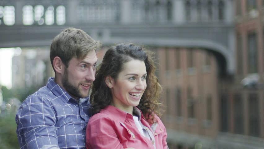 Couple watching amusing sight outdoors   Shutterstock HD Video #27867328