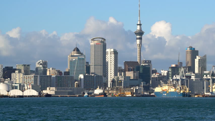 Auckland, New Zealand harbour and city center with Auckland Sky Tower waterfront view from Devonport.