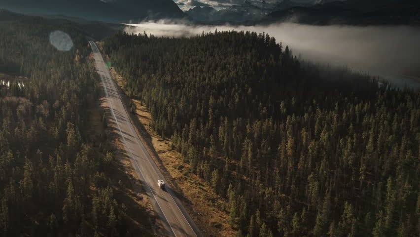 aerial of rv driving on icefields parkway in jasper birds eye