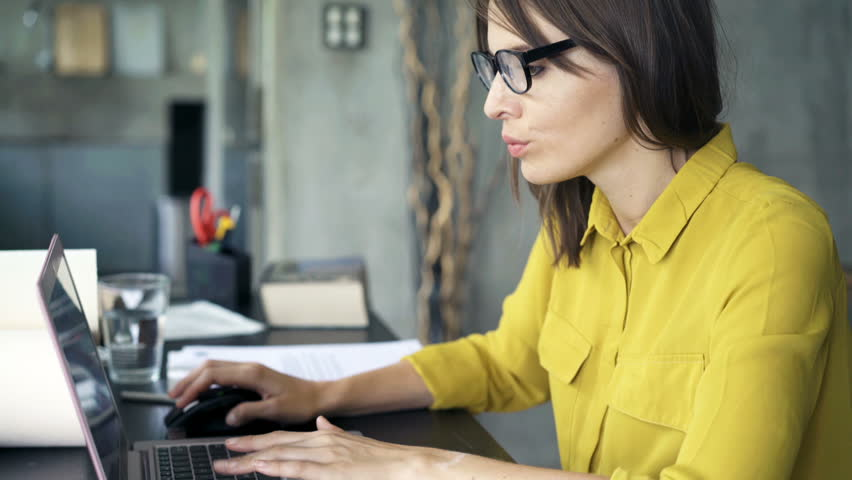 Tired, sleepy businesswoman working with laptop by table at home | Shutterstock HD Video #27905086