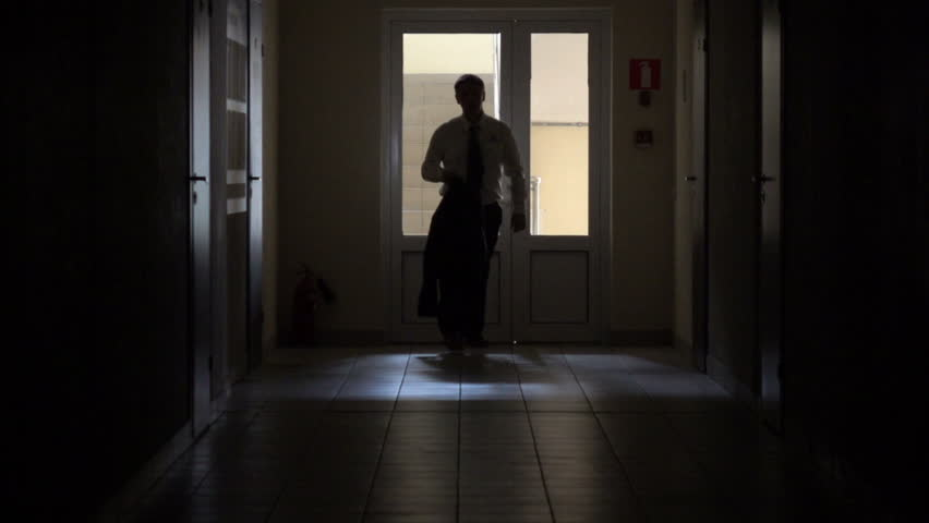 Slow motion. Silhouette of a man runs through the dark corridor. Dismissal.The Ghost of a businessman .The path to success. | Shutterstock HD Video #27920233