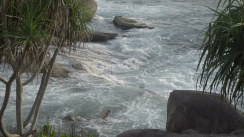 Turquoise waves rolled on the beach of Koh Miang island, Similan Islands, slow motion