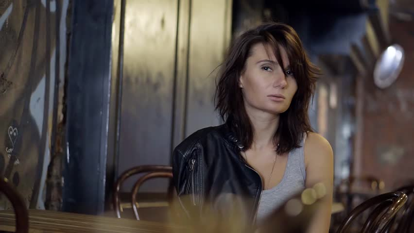 Woman in bad mood sitting at a table in street cafe waiting for his order. Smooth movements of the Steadicam. | Shutterstock HD Video #27957370