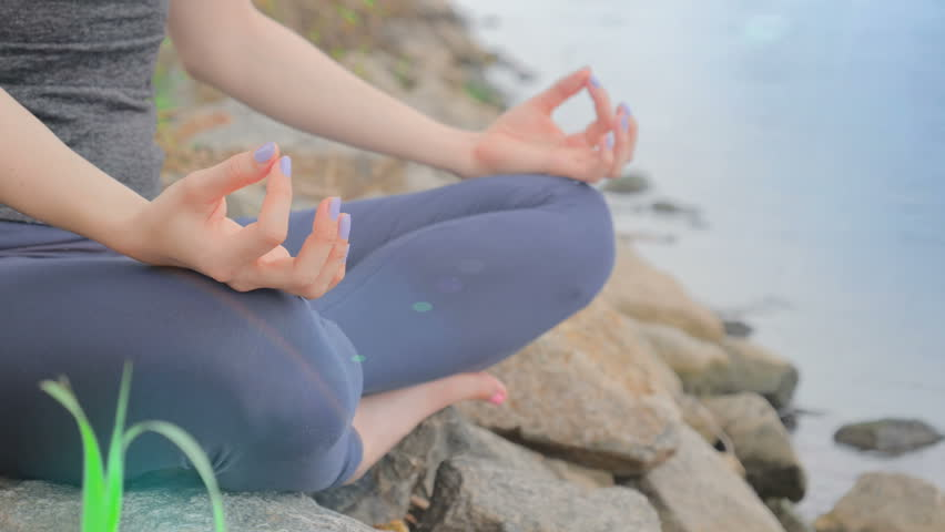 Close up shot of woman's hand. Woman in lotus position in the morning beach. Health and yoga concept | Shutterstock HD Video #27967390