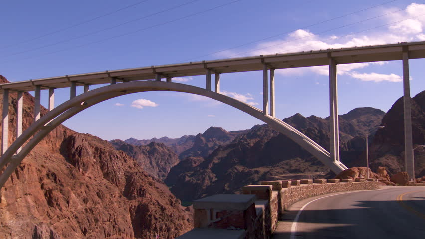 Hoover Dam Memorial Bridge - pans from car to the bridge that connects Arizona and Nevada at the site of the Hoover Dam | Shutterstock HD Video #27987409