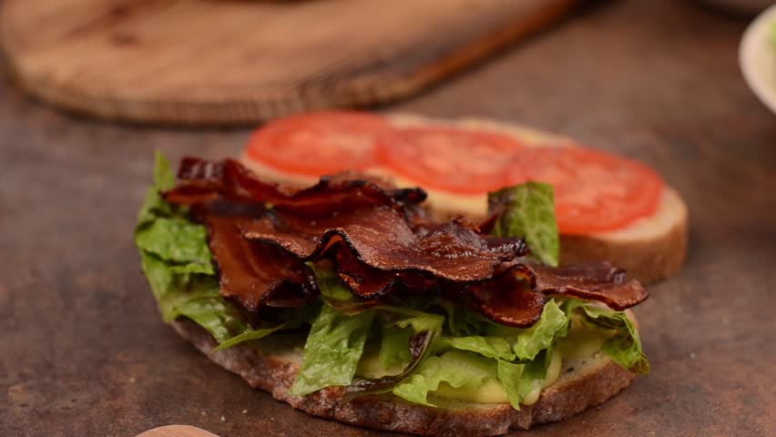 Finishing BLT sandwich | Shutterstock HD Video #28034500