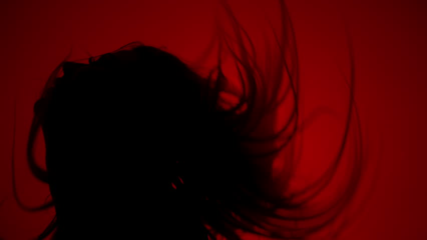 Silhouette of woman shaking hair on red background. Sexy girl silhouette in dark. Sexy woman silhouette in sexual pose in dark. Erotica concept | Shutterstock HD Video #28036930