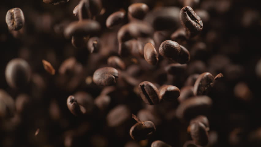 Coffee beans fly after being exploded. Shot with high speed camera, phantom flex 4K. Slow Motion. | Shutterstock HD Video #28040020