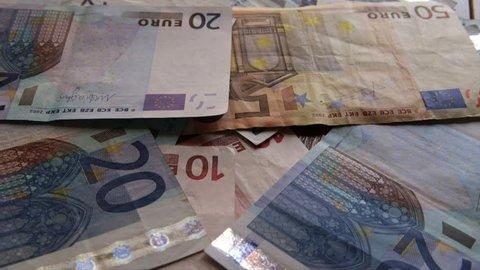 blown banknotes on wooden floor