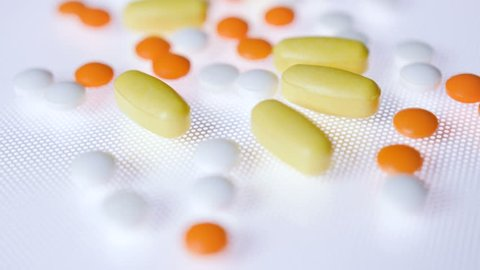 Pills and tablets medicine track shot in 4K. Medical background footage. Forward tracking shot with moving focus.