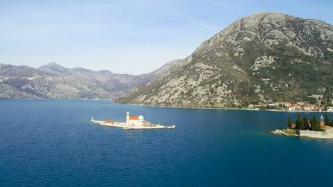 Gospa-od-Skrpjela Island on sunny day aerial view