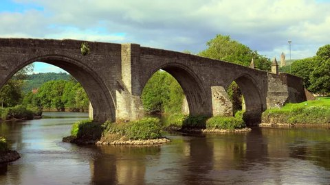 4k footage of the Old Stirling Bridge on a bright sunny day. Horizontal pan right to left.