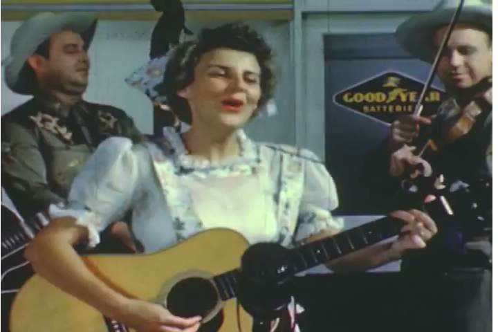 1950s: A female folk musician sings a yodeling song, and men dance on behalf of Goodyear Tires in the 1950s.