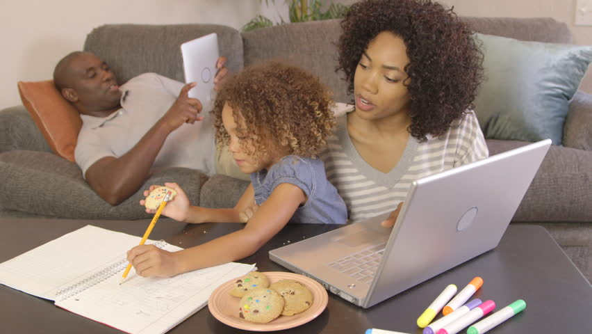 African American family doing homework with laptop   Shutterstock HD Video #2806474