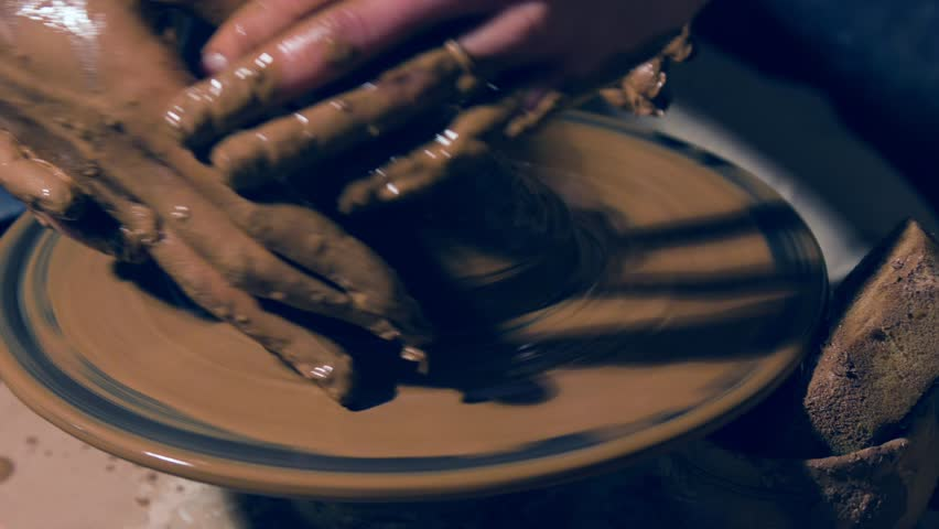 Scaled up shot of ceramist teaching pottery | Shutterstock HD Video #28066264