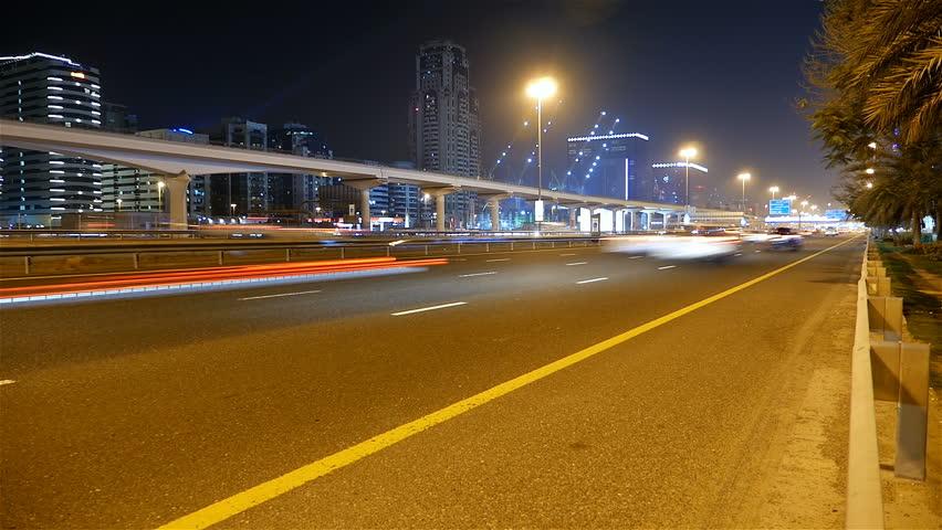 Night shot, time lapse of Dubai Street car traffic and metro station | Shutterstock HD Video #28076584