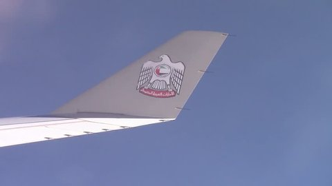 MANILA, PHILIPPINES - CIRCA JUNE 2017:  the logo of the Ethiad Airways on the wing of a passenger airplane in flight in a blue sky. It is a flag carrier of the United Arab Emirates.