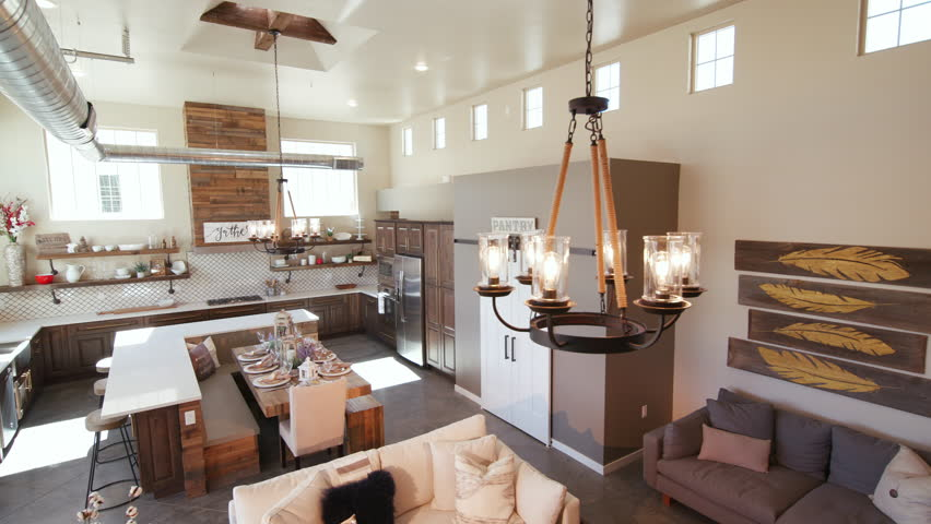 Modern Open Living Space with Kitchen Lower Left Angle. a lowering shot of a unique modern rustic industrial living open floor plan living space with kitchen and high ceilings