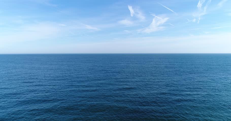 Establishing drone shot of the sea, tilting down