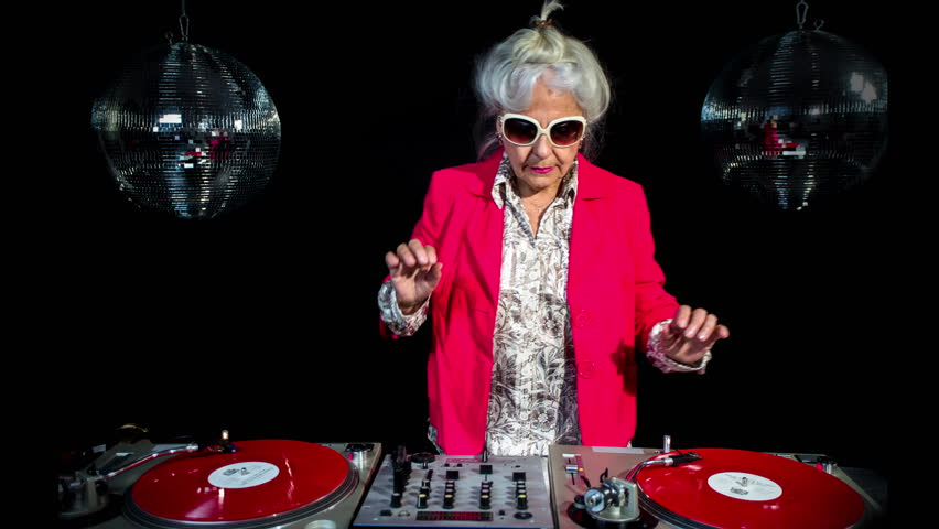 Amazing DJ grandma, in a disco setting.  this retired rockers will get the party going | Shutterstock HD Video #28118125