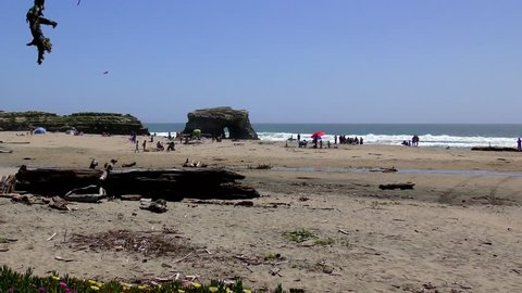 Unidentified people at the Natural Bridges State Beach, Santa Cruz California, USA, circa April 2017