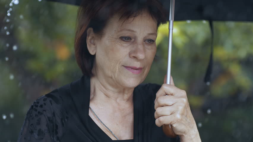 Woman with umbrella under rain