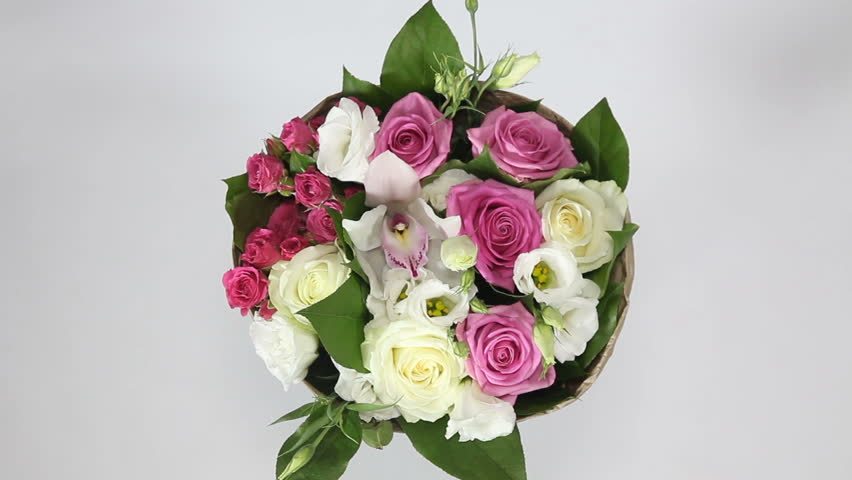 Bouquet of roses, eustoma and orchids turns on white background. top view | Shutterstock HD Video #28132789