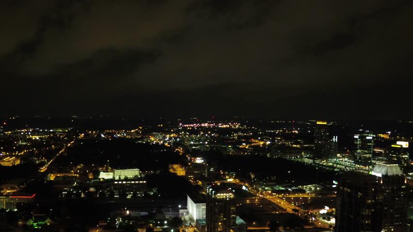 Atlanta Aerial v245 Flying through midtown at night panning during lightening storm   Shutterstock HD Video #28142350