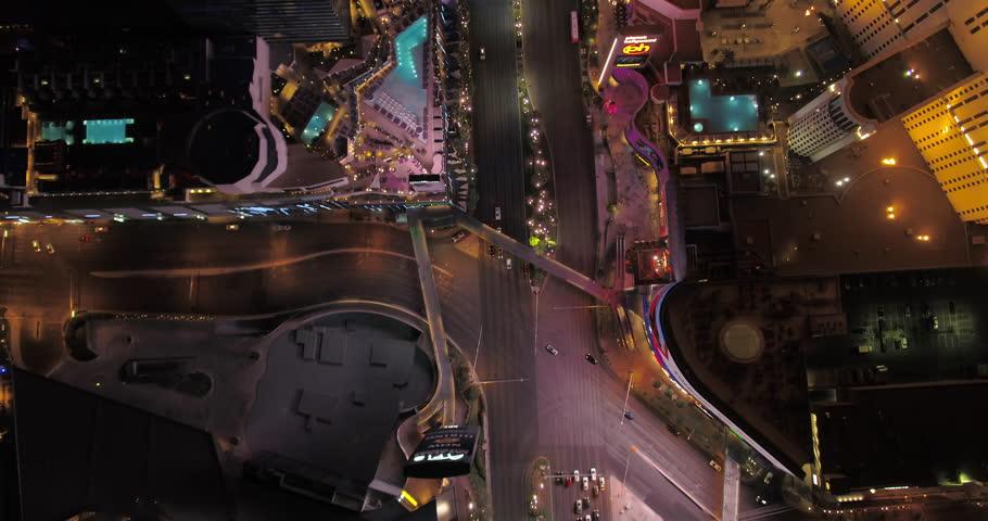 Las Vegas Aerial v41 Flying over main strip blvd looking down vertically at night 4/17