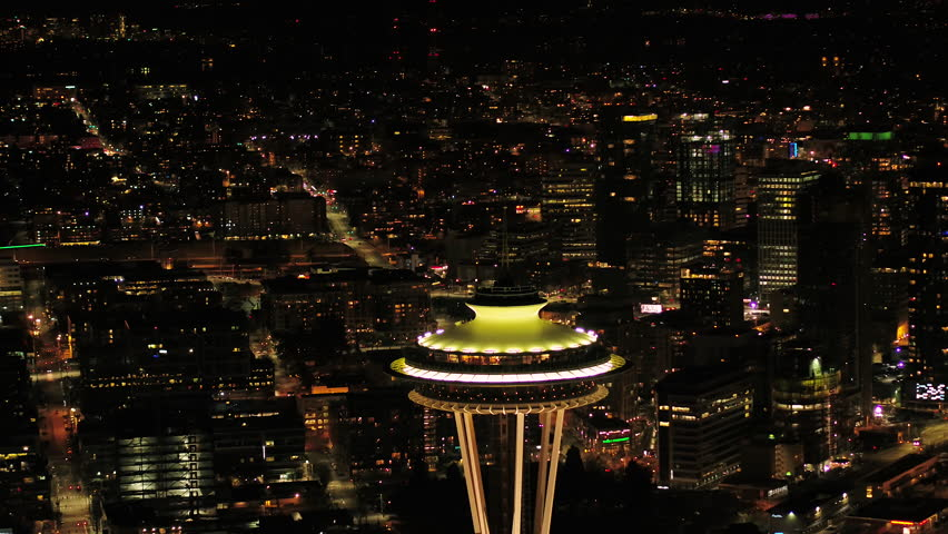 Seattle Aerial v104 Closeup shot flying around Space Needle at night 4/17