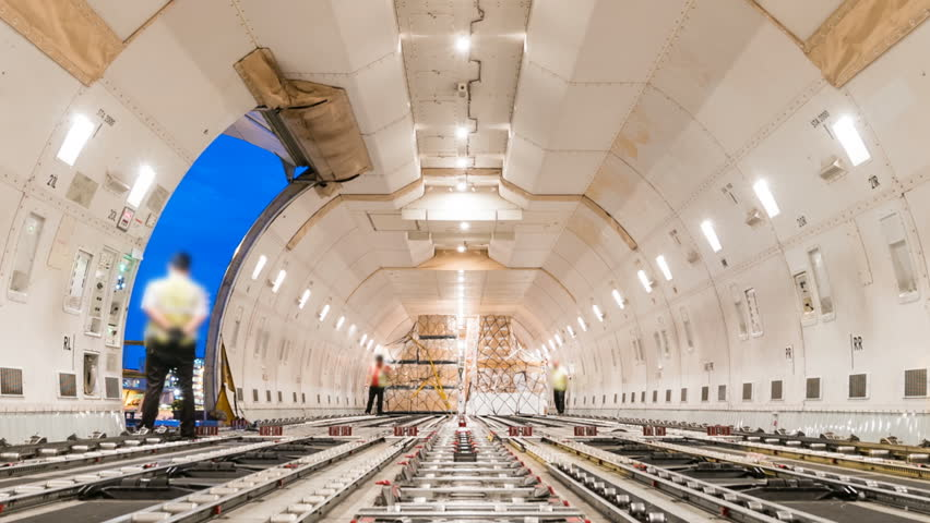 Loading air cargo freighter inside aircraft - Zoom out