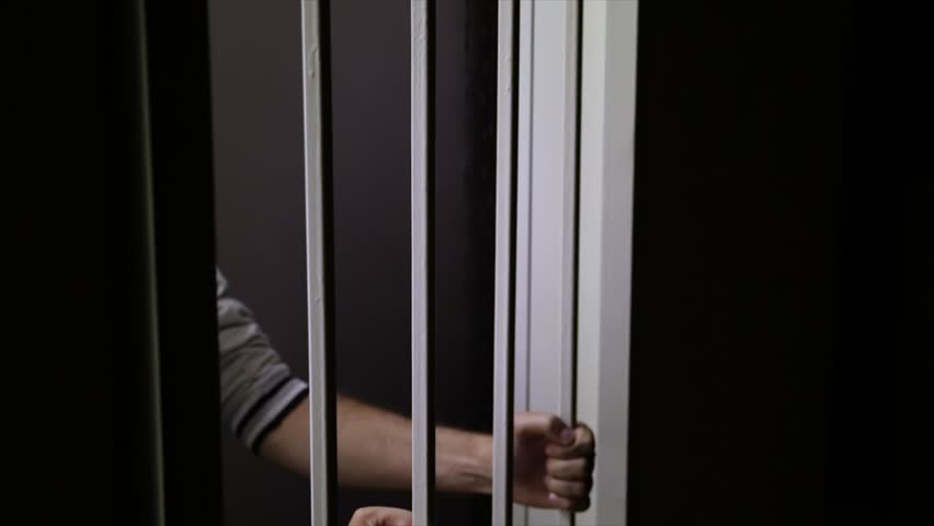 Convict behind bars | Shutterstock HD Video #2815249