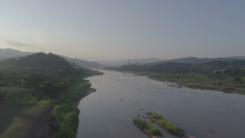 Aerial view of Mekong river between Chiang Khong, a small town in Chiang Rai Province, Northern Thailand and Houay Xai, the capital of the Laos province of Bokeo Royalty-Free Stock Footage #28152508
