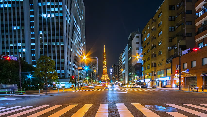 4K. Time Lapse nighttime fast speed traffic in Tokyo city and Tokyo tower of Japan is a famous place