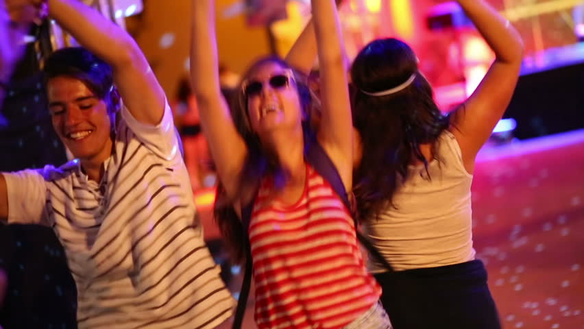 Group of friends having fun and dancing at concert | Shutterstock HD Video #28157551