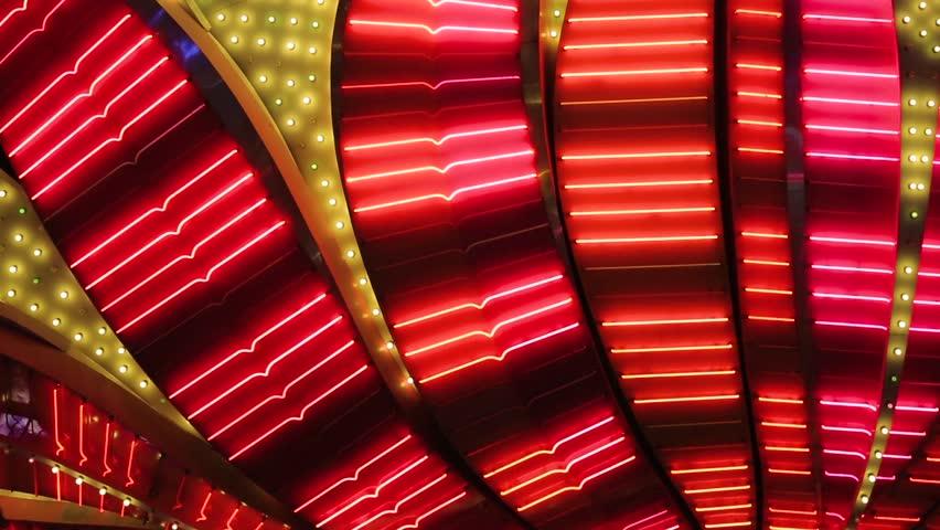 Las Vegas Neon Lights close-up. Neon flashing lights of Las Vegas Casino. Flashing neon light on the famous Las Vegas Strip. Bright night entertainment and advertisement at resort hotel and casino.