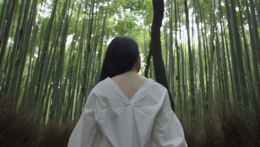 Beautiful Japanese women walking through bamboo forest early morning alone 4k.