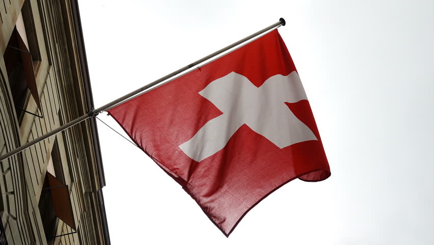Swiss flag waves in the wind from a Building- slow motion   Shutterstock HD Video #28184047