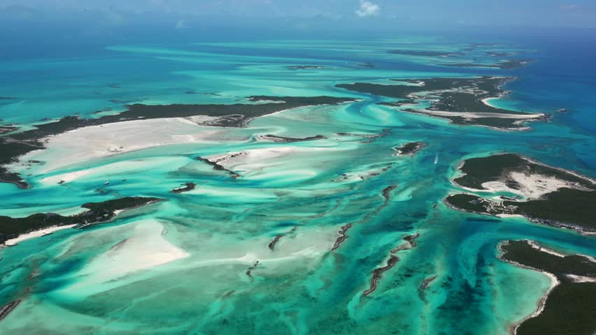 Exumas Bahamas Island Chain, beautiful afternoon AERIALS of colorful water and sand patterns view North at 2000 feet. | Shutterstock HD Video #28185076